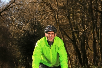 Richard cycling in a wood