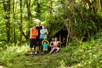 The whole family making a den in the woods