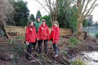 Naomi, Katie and Jess from the education team with woodlands officer Nick, busy preparing the outdoor classroom at The Canons CE Primary in Bedworth.