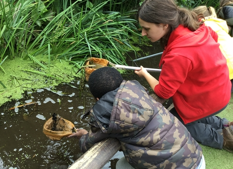 Education Officer Naomi pond dipping Paula Irish